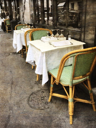 "A beautiful table setting at a café in Paris defines ""Sidewalk Elegance."""