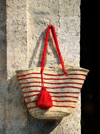 "French flair seen in the jaunty red stripes of this ""Cherry Tassel"" tote bag."